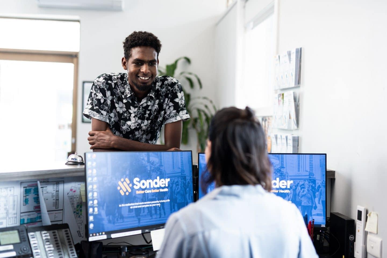 Sonder Receptionist welcoming Client